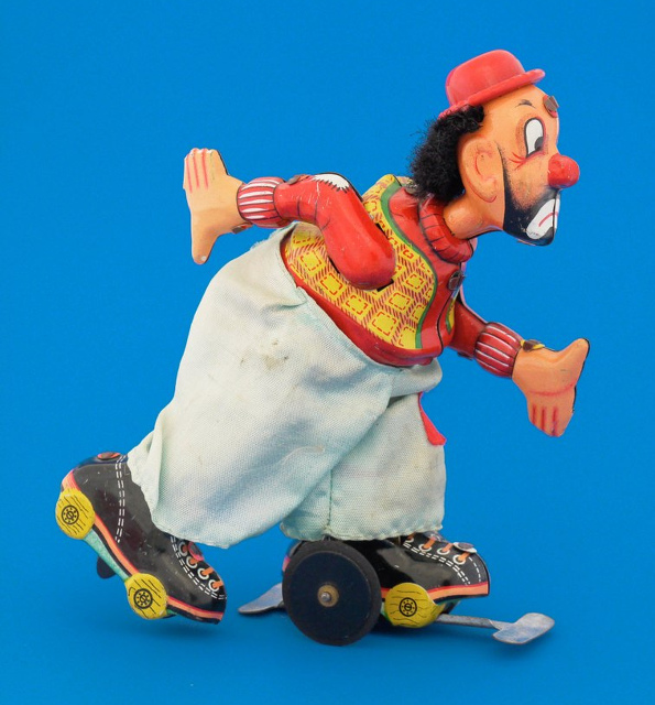 A tin plate roller-skating clown
