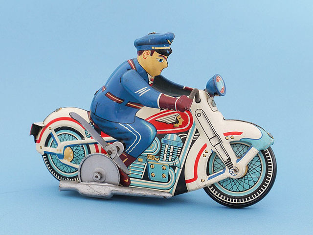 A Japanese tin toy policeman riding a motorbike