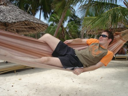 Mike on a hammock at the beach in Diani Reef, Kenya